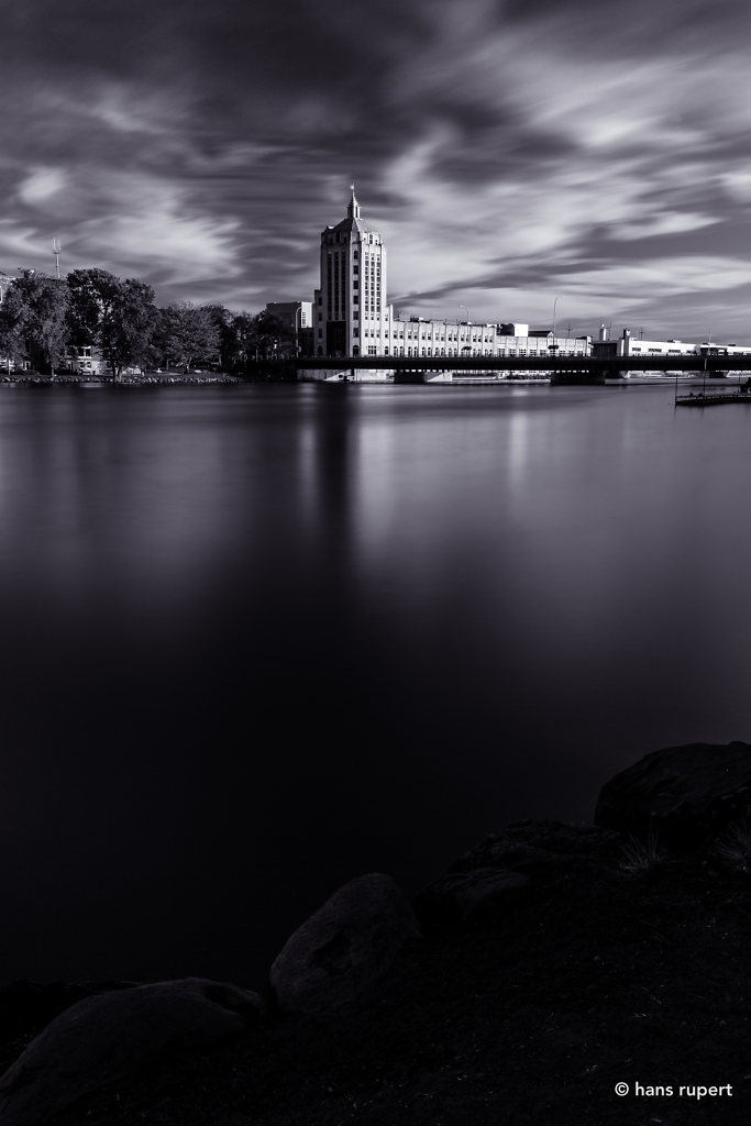 News Tower On A Quieted River